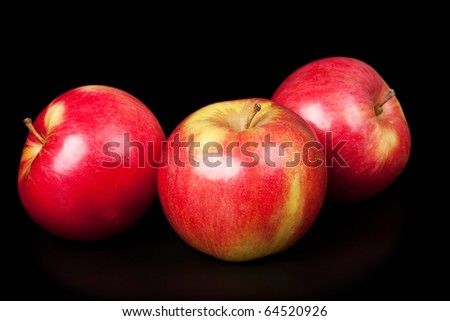 red apples isolated on  black - stock photo