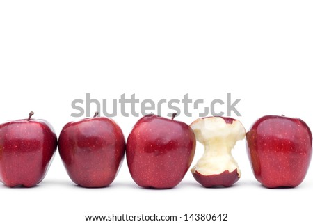 Red apples line up on a white background with one eaten apple