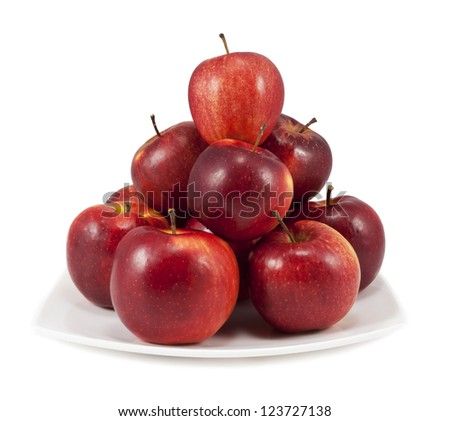 Red apples on a white plate isolated on white background - stock photo