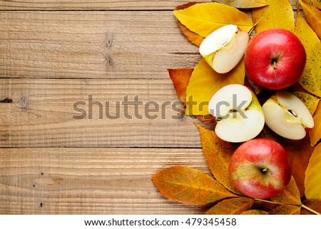 Red apples on autumn leaves top view