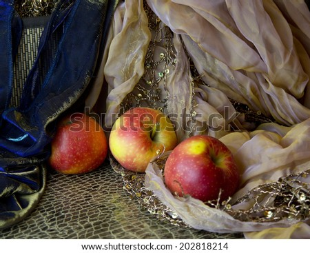 red apples on fabric with embroidery. still life