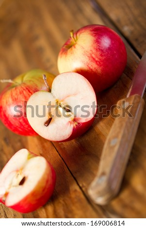Red apples on old wooden table - stock photo