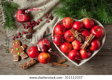 Red apples with Christmas decoration balls , cinnamon and gingerbread