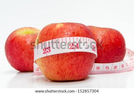 Red apples with measurement isolated on white