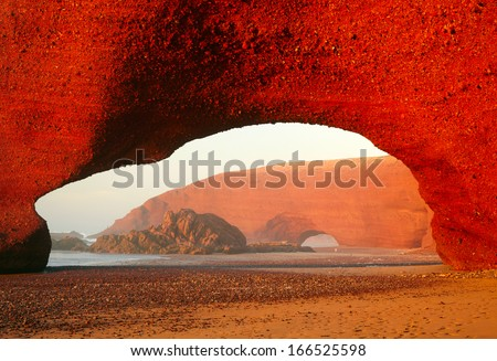 Red archs on atlantic ocean coast. Marocco - stock photo