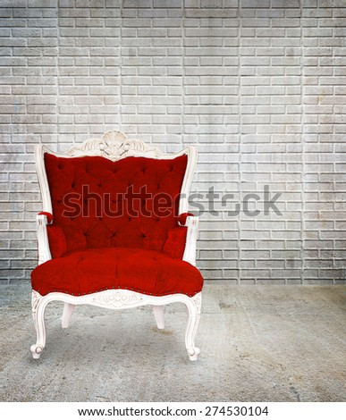 Red armchair classical style in grunge vintage room, interior design