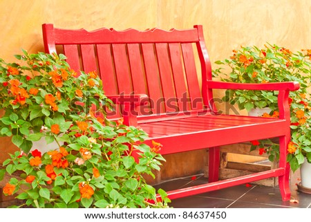 Red armchair setting at indoor garden - stock photo