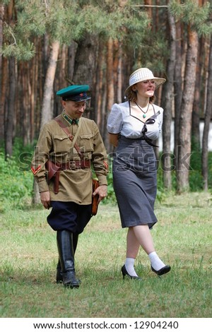 Red Army officer with girl. WW2 reenacting