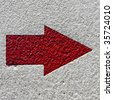 red arrow on white texture - stock photo