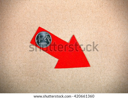 Red Arrow with Russian Ruble on the Cardboard Background - stock photo