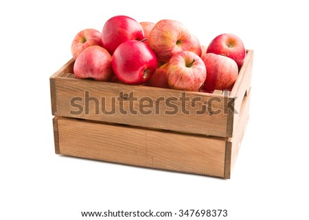 red autumn apples in wooden box on white background