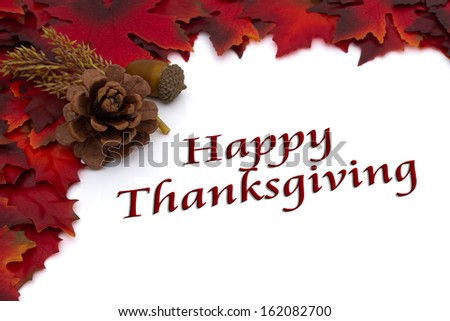 Red Autumn Leaves and a Pine Cone Background isolated on white with text Happy Thanksgiving, Autumn Time Happy Thanksgiving - stock photo