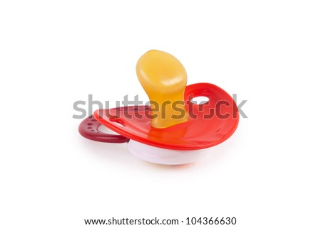 Red baby's dummy isolated on white - stock photo