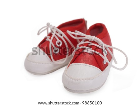 Red baby sneakers on white background - stock photo