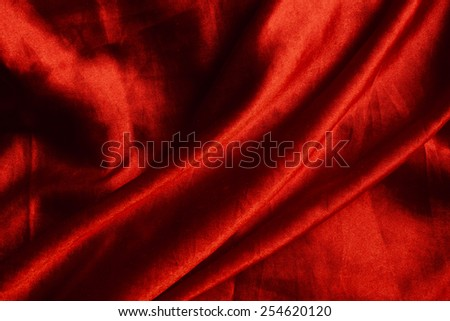 red background abstract cloth of wavy folds of silk texture satin or velvet material or  wallpaper design of elegant curves red material - stock photo