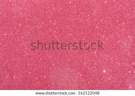 red  background from wrapping paper with glitter - stock photo