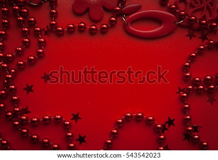 red background with red beads and red stars