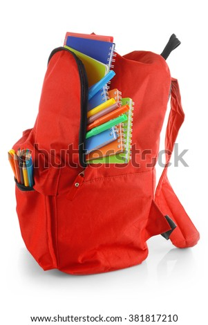Red backpack with colourful stationary isolated on white background - stock photo