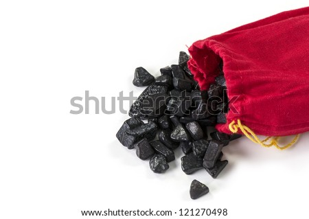 Red bag of coal isolated on white - stock photo