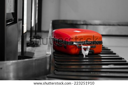 Red bagged on the conveyer in the air port.  - stock photo