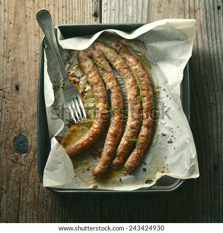 Red baked delicious juicy sausages in row - stock photo