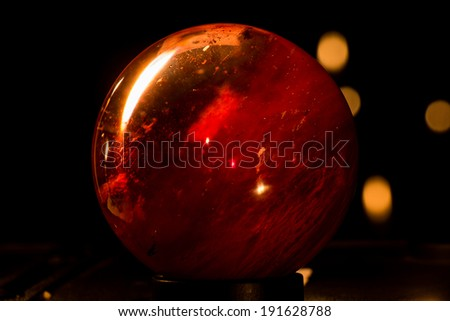 Red ball glass sphere  look like Mars - stock photo