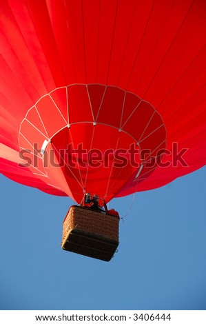 Red balloon flying in the air. - stock photo