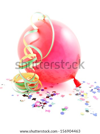 Red balloon, streamers and confetti over white background