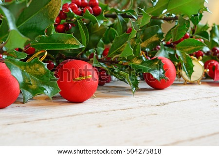 Red balls of Christmas and holly