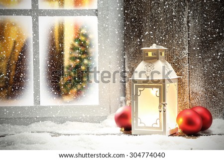 red balls white lamp and xmas window sill  - stock photo