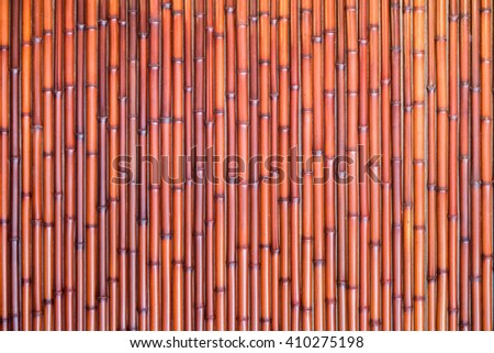 red bamboo fence background - stock photo