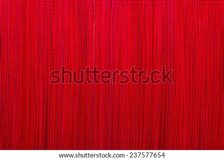 Red bamboo mat texture or background - stock photo