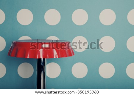 Red bar stool against a background of wall - stock photo
