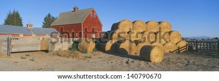 Red barn and haystacks, Idaho Falls, Idaho - stock photo