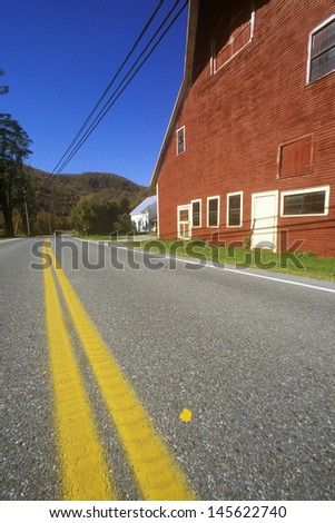 Red barn by side of Scenic Route 100 in autumn, VT - stock photo