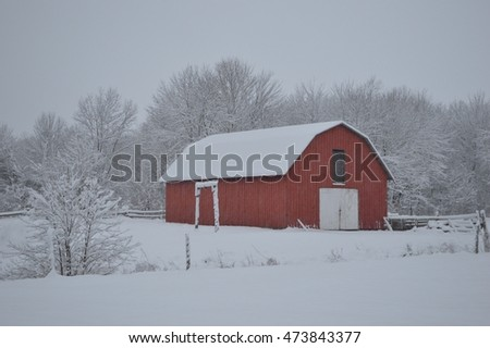Red Barn Front in Snow Storm Angle View