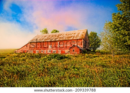 Red barn in a field, Stowe, Vermont, USA - stock photo