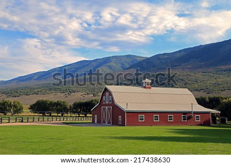 Red barn in the Wasatch Mountains, Utah, USA. - stock photo