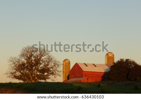 Red barn, lit by the sunrise