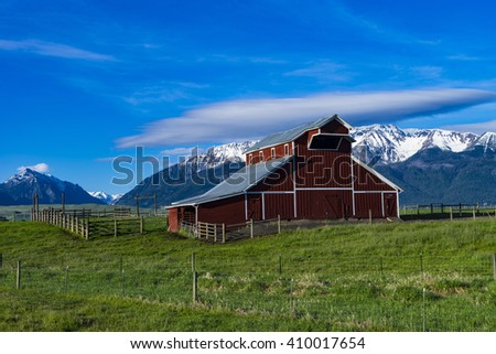 Red barn near the Wallowa Mountains in Oregon - stock photo