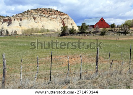 Red barn on a farm in the Utah desert, USA. - stock photo