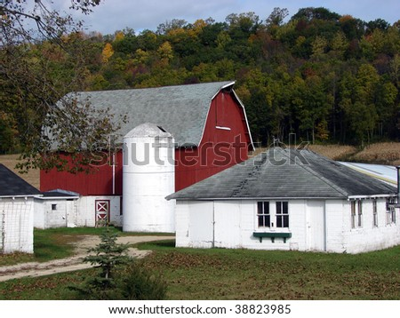 red barn white farm buildings