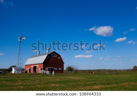 Red barn with clear blue sky - stock photo