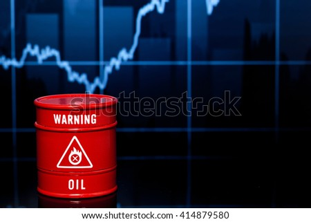red barrel of oil on blue chart - stock photo