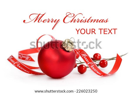 Red bauble with merry Christmas ribbon on a white background - stock photo