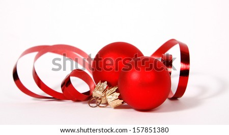 Red baubles with the ribbon on the white background - stock photo