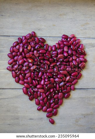 Red beans background with burlap bag and wooden spoon - stock photo