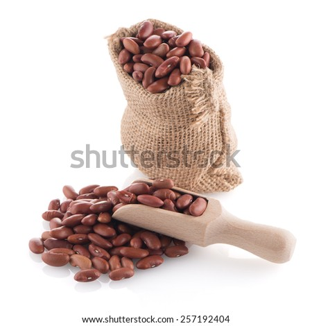 Red beans bag with wooden scoop on white background. - stock photo