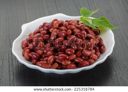 Red beans from can with leaf - stock photo