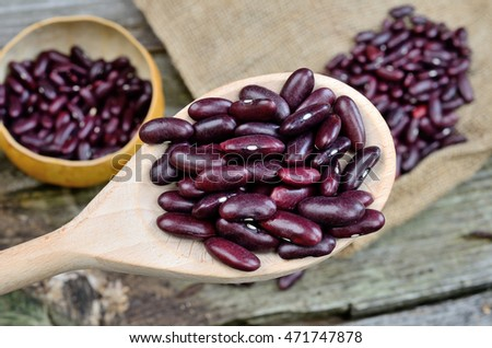red beans in wooden spoon on table